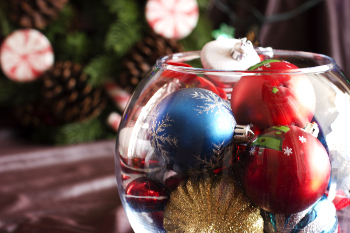 Photo of Christmas tree ornaments in a fish bowl.